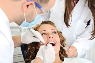 Cosmetic Dentistry Centerville - Dentist Checking a Patient