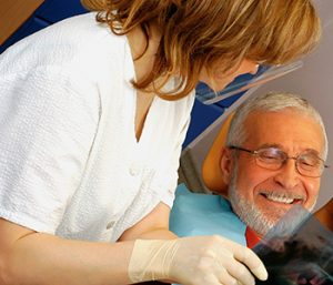Dr. Daniel Cobb, Alex Bell Dental Image Of Matured Happy Patient