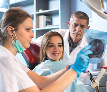 Dr. Daniel Cobb, Alex Bell Dental Image Of Doctors and Patient