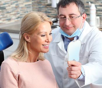 Dr. Daniel Cobb, Alex Bell Dental Doctor with patient