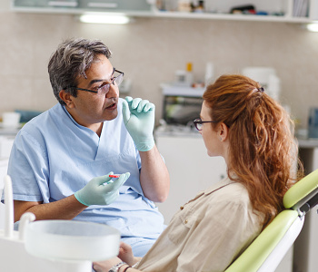 Dr. Daniel Cobb, Alex Bell Dental Dayton dentist discusses the difference between a crown and a bridge for a missing tooth